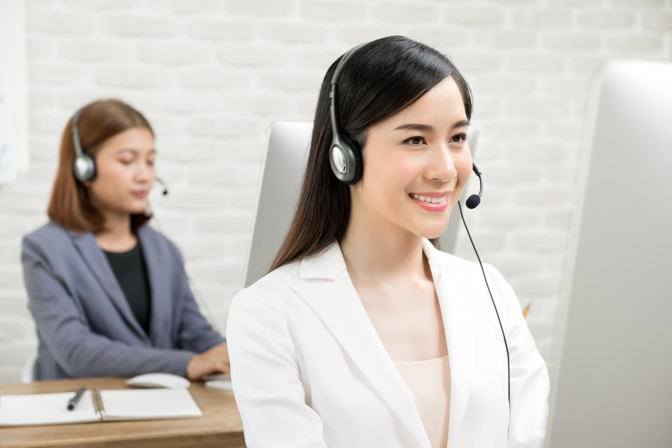 Asian-businesswomen-wearing-headsets