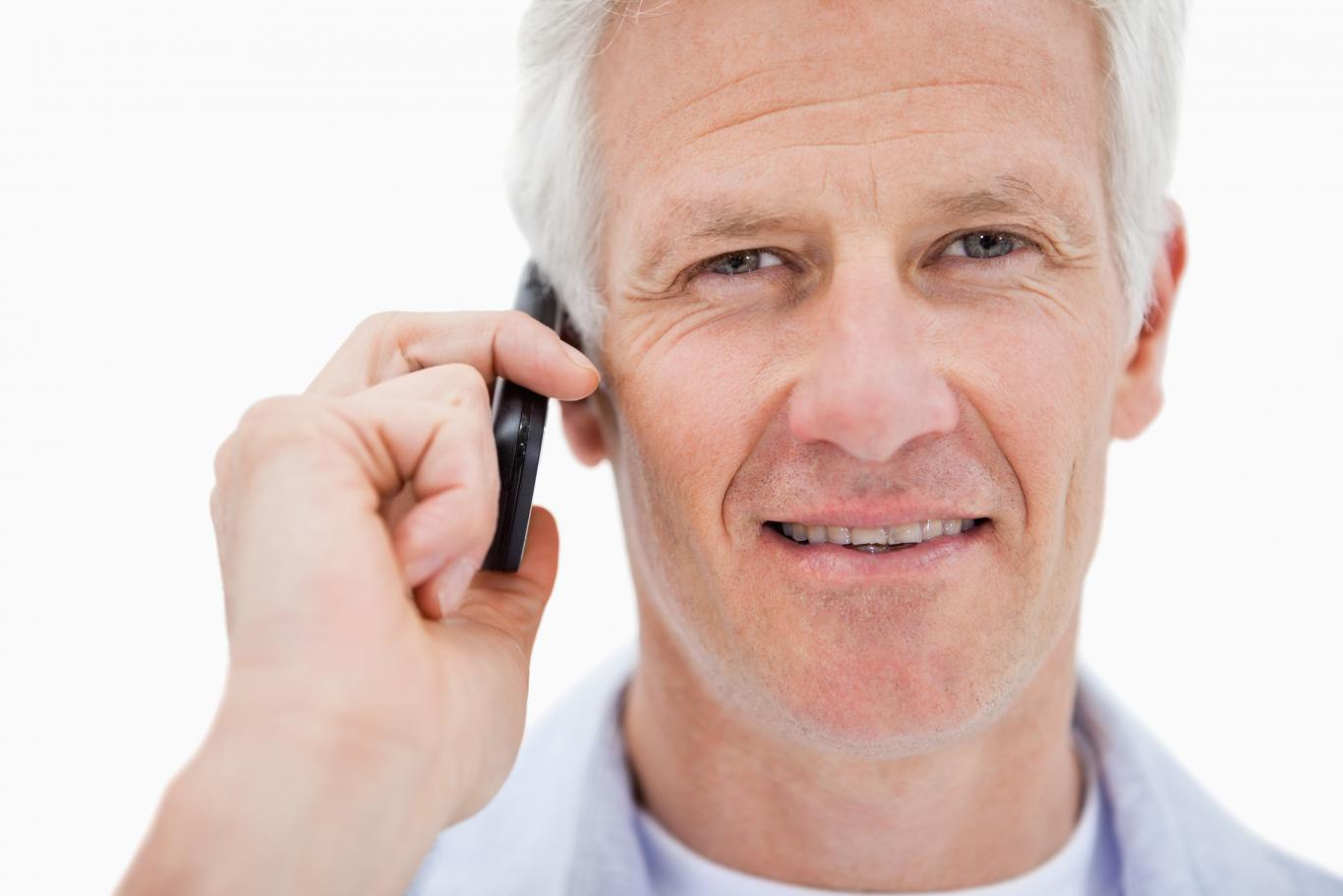 Smiling-mature-man-making-phone-call